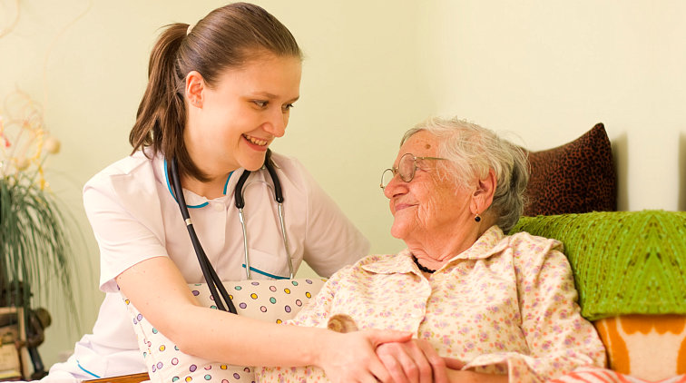 nurse and patient smiling at each other