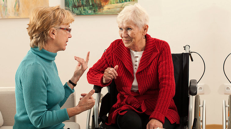 lady and old woman talking