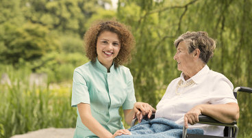 patient smiling at her caregiver
