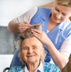 nurse combing patient's hair