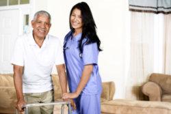 nurse assisting an elderly man